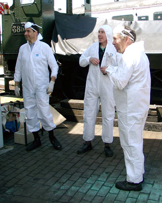 The lagging is a dusty job so those involved were kitted out in special protective clothing. They are, from the right, John Salter, Chris Brown and Richard Abbey. June 19 2004
