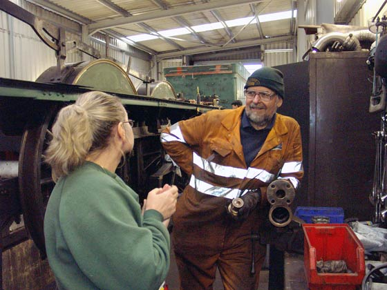 Angie Hailwood (left) distracts Colin Henderson from his work, which was overhauling the right hand side injector. January 10 2004
