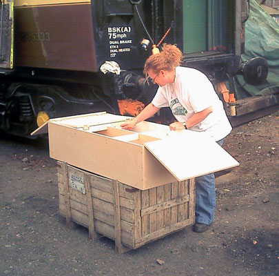 Angie Hailwood works on the cupboard from the kitchen. July 24 2004 © John Salter