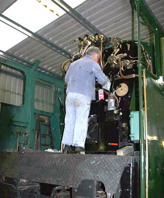 Brian Dodd polishes some of the refitted backhead pipework. June 20 2004 © Huw Button