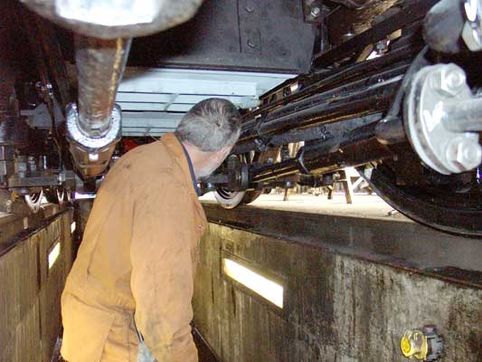 Underneath the loco Colin Henderson lagged and refitted the steam feed to the air pump. August 21 2004