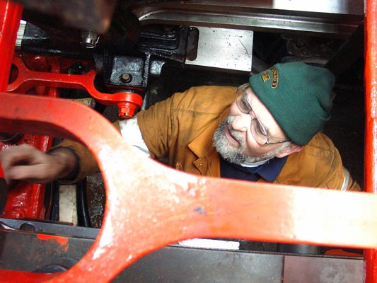 Colin Henderson in between the frames during the con rod refitting. February 07 2004
