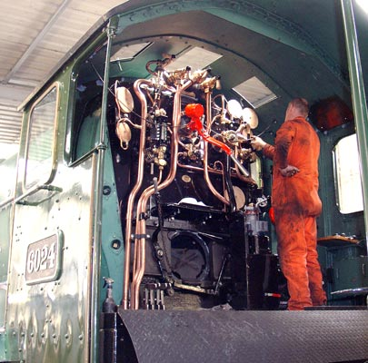 There are currently no gauges fitted in the cab but this is in hand. Steve Underhill is seen working on finalising where the steamchest pressure gauge is to be mounted. August 01 2004