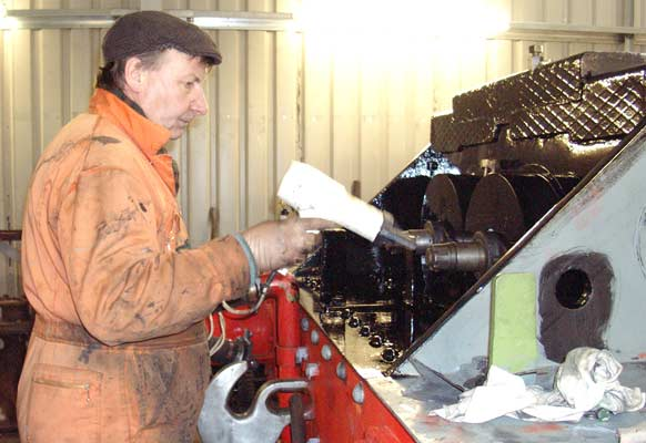 Dave Fuszard takes his hairdryer to the front of the engine to help the paint dry in the damp and cold. January 10 2003