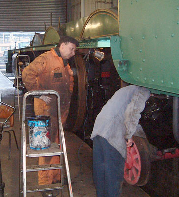 Dave Fuszard and Alex Hayes at work on the frames. As can be seen the cabside has now been given an undercoating. February 14 2004 © Colin Henderson