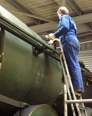 Graham Hopes applies top coat number 3 to the boiler. August 15 2004