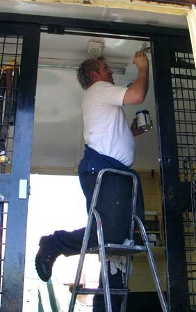 Huw Button paints the ceiling. Huw likes painting and is available to paint other carriages if you wish him to do so..... August 07 2004