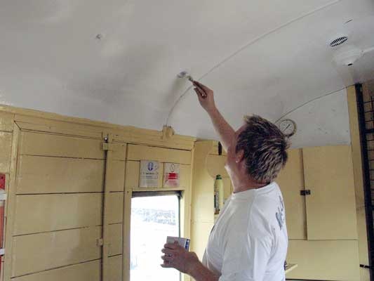 Back on his favourite task Huw Button finished giving the carriage ceiling a second coat of white. August 21 2004
