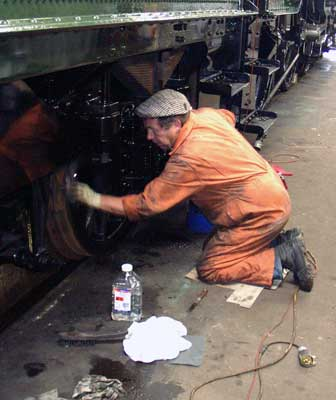 John Salter cleans a tender wheel before painting it. August 28 2004