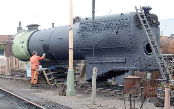 John Salter finishes off painting the boiler barrel. May 01 2004