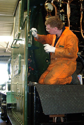 Kevin Blake paints the inside of the cab. August 07 2004
