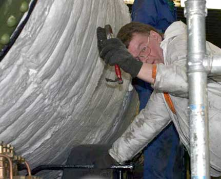 Kevin Blake was also to be found working at insulating the boiler. June 20 2004 © Huw Button