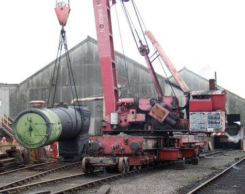 With the ashpan secured the crane brewed up to lift the boiler to allow the frames back underneath. May 11 2004