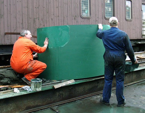 Mick Carr (left) and Huw Button rub down one of the cladding sheets. April 17 2004