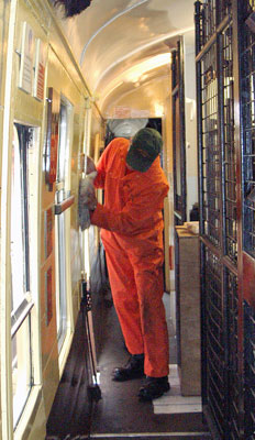 Pete Archer gives the interior a good wipe over to remove accumulated dust and muck. June 26 2004