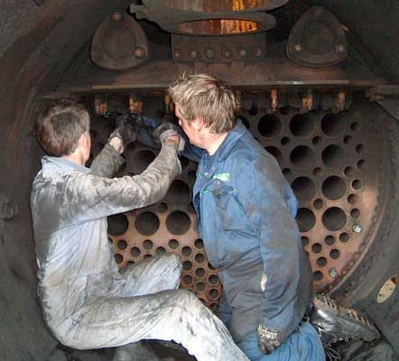 Richard Jones (left) and Huw Button work at removing the superheater header blanks fitted for the hydraulic and steam tests. May 15 2004 © Colin Henderson