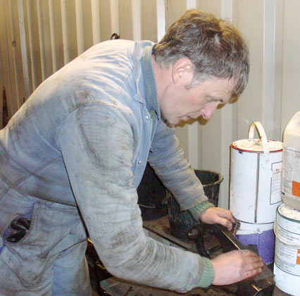 Richard Jones rubs down part of the mechanical lubricator drive. January 10 2004