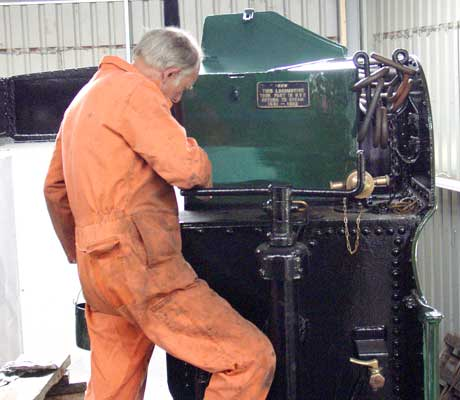 Roger Fox gives one of the tender tool boxes a top coat. August 21 2004