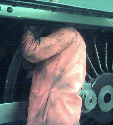 Someone at work under the running plate on the fireman's side. July 17 2004 © John Salter