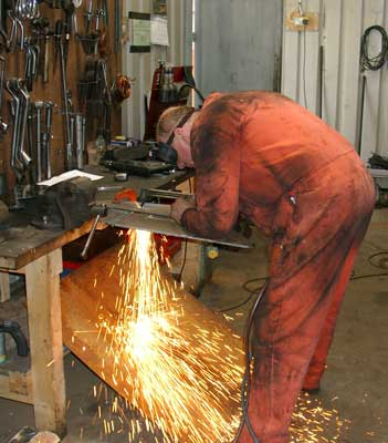 Steve Underhill cuts a new mount for the air brake gauges. August 07 2004