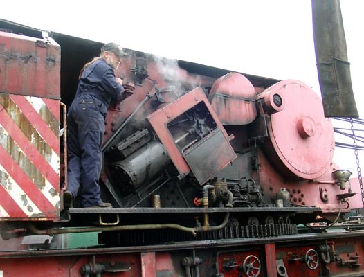 Crane driver Steve Lester brings the TLW steam crane into position for the lift. May 11 2004