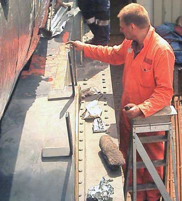 Tim Watson spent more time filling the top of the fire iron tunnel to get a good smooth surface on which to paint. May 29 2004 © John Salter