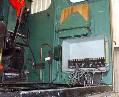 The AWS relay box below the driver's seat has been opened up to be unwired before being removed for good. August 07 2004