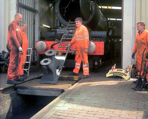Four blokes and one very heavy double blastpipe. From the right Kevin Blake, Richard Corser, Keith Lines and Steve Underhill prepare to move the blastpipe into the smokebox. July 24 2004 © John Salter