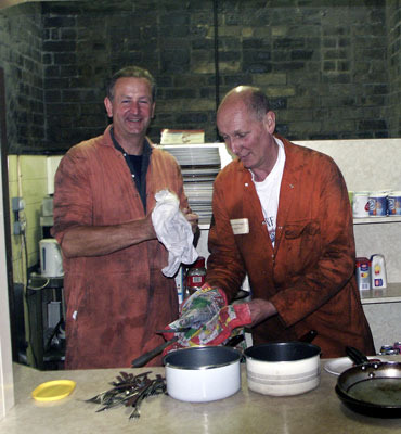 A bit of a first for our Chairman we think. Steve Underhill helps Paul Sanders wash up after breakfast. June 14 2003