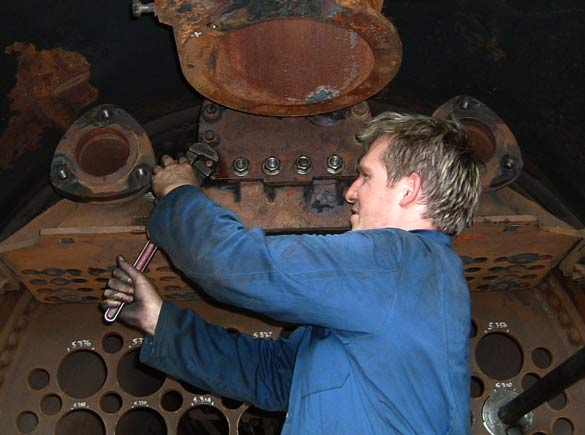 Huw Button works on replacing the studs in the superheater header over which the regulator cover fits. July 19 2003 © Colin Henderson