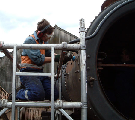 The in between. Your webmaster wire brushes the smokebox prior to painting. July 19 2003 © Colin Henderson