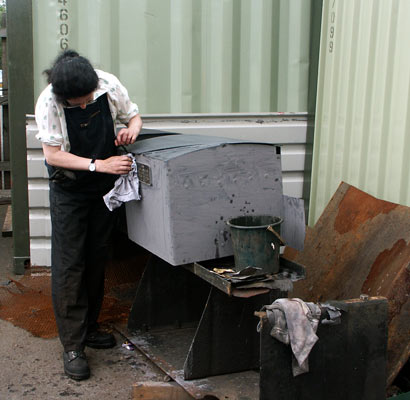 Alex Hayes prepares the fireman's side toolbox for painting. July 27 2003
