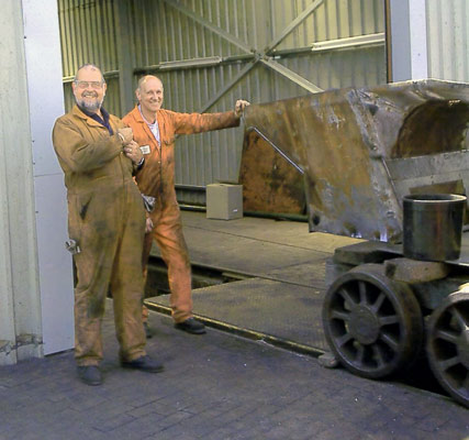 Colin Henderson (left) and Steve Underhill pose with the partially repaired ashpan. June 21 2003 © John Salter