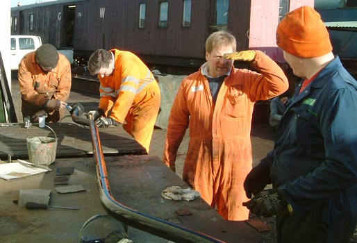 From the right Huw Button, Tim Watson, Richard Corser and Dave Fuszard demonstrate how many blokes are required to sort out a piece of brake pipe. January 17 2004 © Colin Henderson