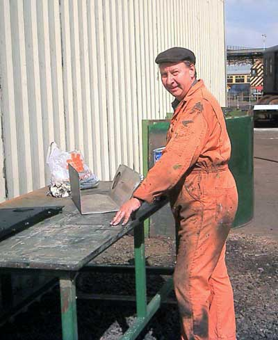 Dave Fuzard took up his normal position outside the shed working on cladding sheets. September 6 2003 © John Salter