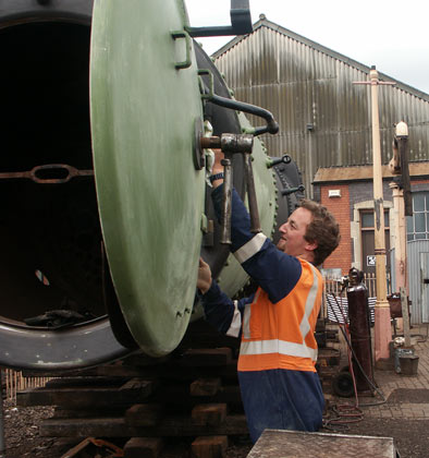 Meanwhile visiting Australian Jeremy Phelan prepares the smokebox door for a second coat. July 27 2003