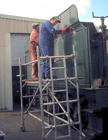 John Salter (left) and Leon Salter work on removing paint burnt during the welding in of the new coal space. September 6 2003