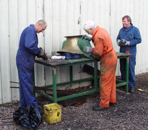 The the left Ron Smith, Bob Robson and Keith Hudson prepare various bits and pieces for a coat of paint. November 9 2003