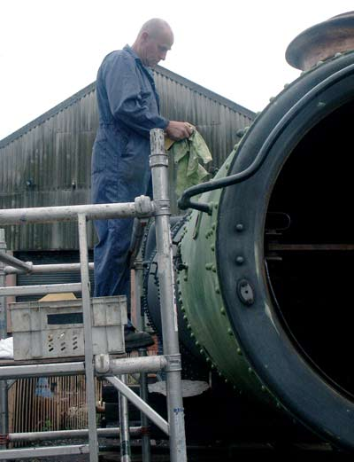 Ron Smith prepares the smokebox for a second coat of primer. July 27 2003