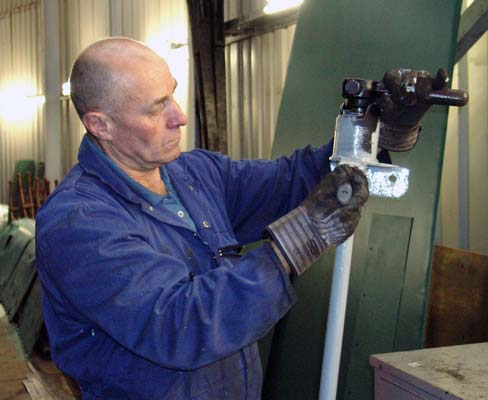Ron Smith paints one of the injector water valve controls. November 2 2003