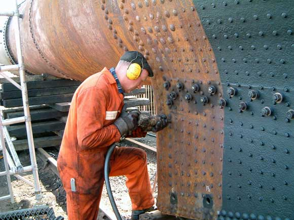 Steve Underhill working away with an air tool on the stays. March 16 2003. © Colin Henderson