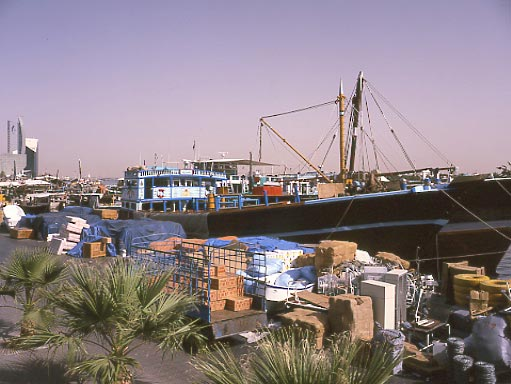 Dubai is a fascinating mix of old and new. Here a wooden hulled boat is unloaded. May 2001