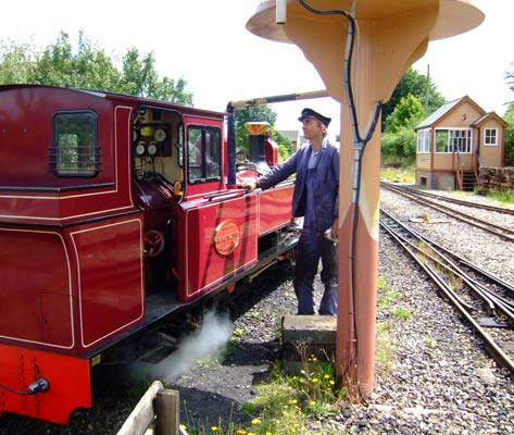 The engineer behind the radical improvements to 'Mark Timothy', Ian Gaylor, is seen here topping up the loco's tanks. 28 June 2006