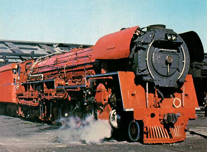 "South African Railways ""26"" class 4-8-4 No.3450, ""L.D.Porta"" (nicknamed the ""Red Devil""), at Paarden Eiland shed, Cape Town, on February 10, 1982. Photo: ""Rooinek"""