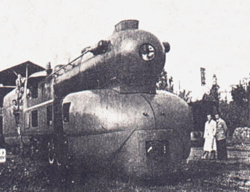 With some of the construction team present the almost finished locomotive is again seen outside the workshop. 1949.