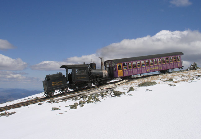 No.9 and purple carriage wait for time to head down the mountain. © Nigel Day