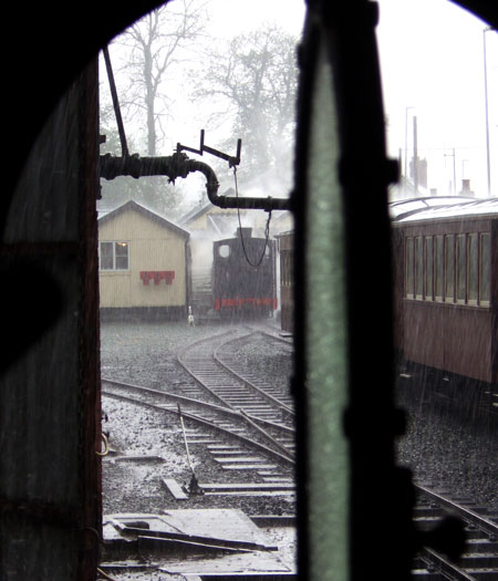 Sometimes it rains in Wales. No.14 waits for the rain to subside at Llanfair Caerenion, viewed from the footplate of No.19. 04 May 2008