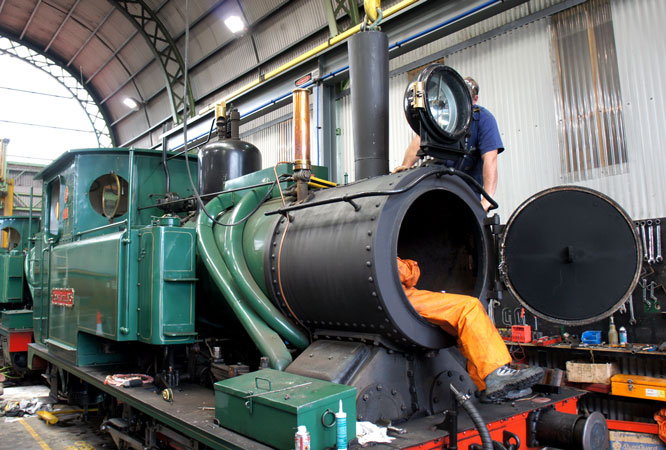 Fitting the fabricated diffuser and mixing chamber to Mount Lyell No.5 in the workshops at Queenstown.