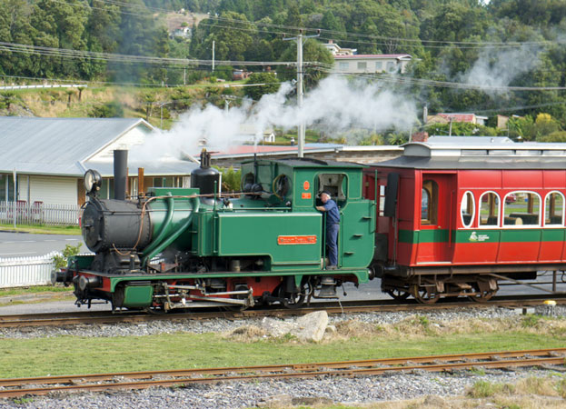 Mount Lyell No.5 runs past the workshop heading for Queenstown station.