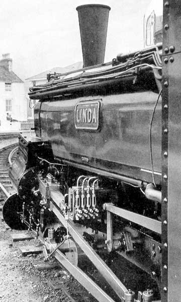 """Linda"" at Porthmadog Harbour Station. Note the pipes carrying exhaust steam to the ashpan along the saddle tank. © N. Gurley"